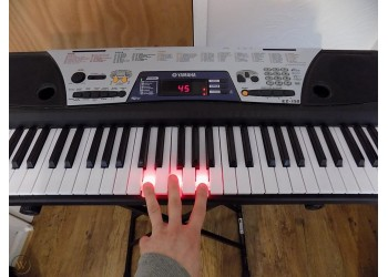 Yamaha EZ150 Lighted Portable Keyboard with Stand
