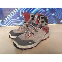 Woman's High ankle Waterproof Trekking shoes by Quechua